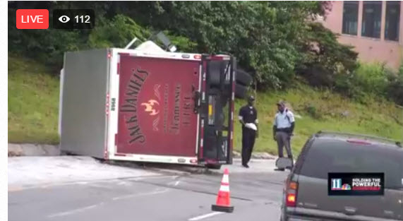 Jack Daniel's truck overturns during rush hour